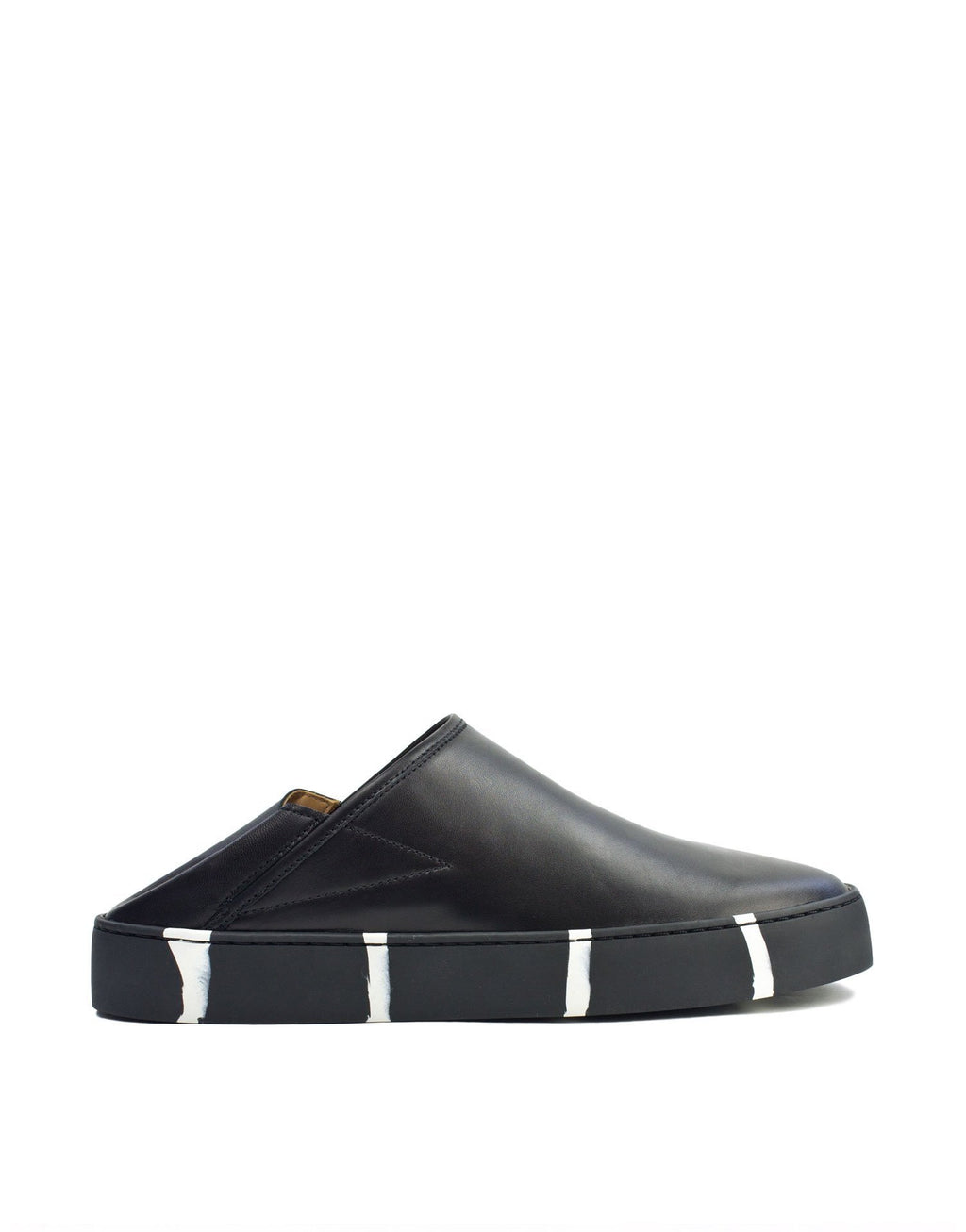 Black slip on sneaker by designer Georgina Goodman with kick down back. These sneakers are perfect for summer. Sample sale sneakers.