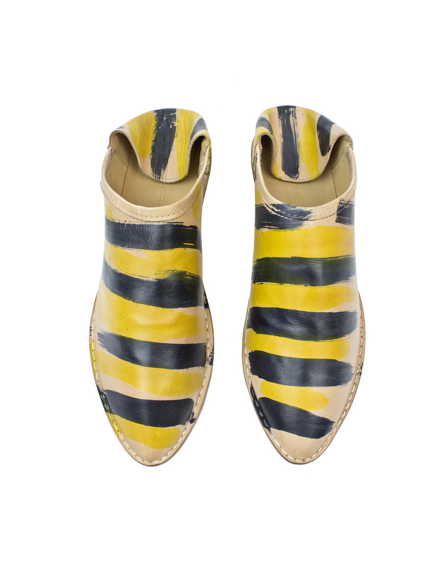 Black and yellow striped slip on slipper shoe by designer Georgina Goodman, hand painted in London by the designer herself this shoe is made from butter soft calf leather with a hidden 2cm wedge and padded insole for comfort, this is style for any age.