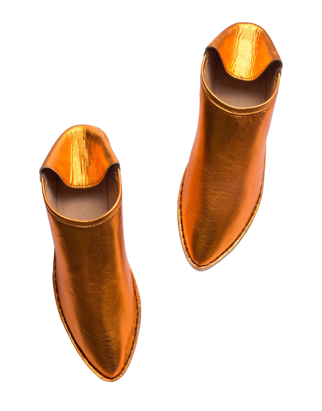 Orange metallic babouche by designer Georgina Goodman with internal wedge and leather sole with non slip rubber insert. The outdoor shoe with an indoor attitude.