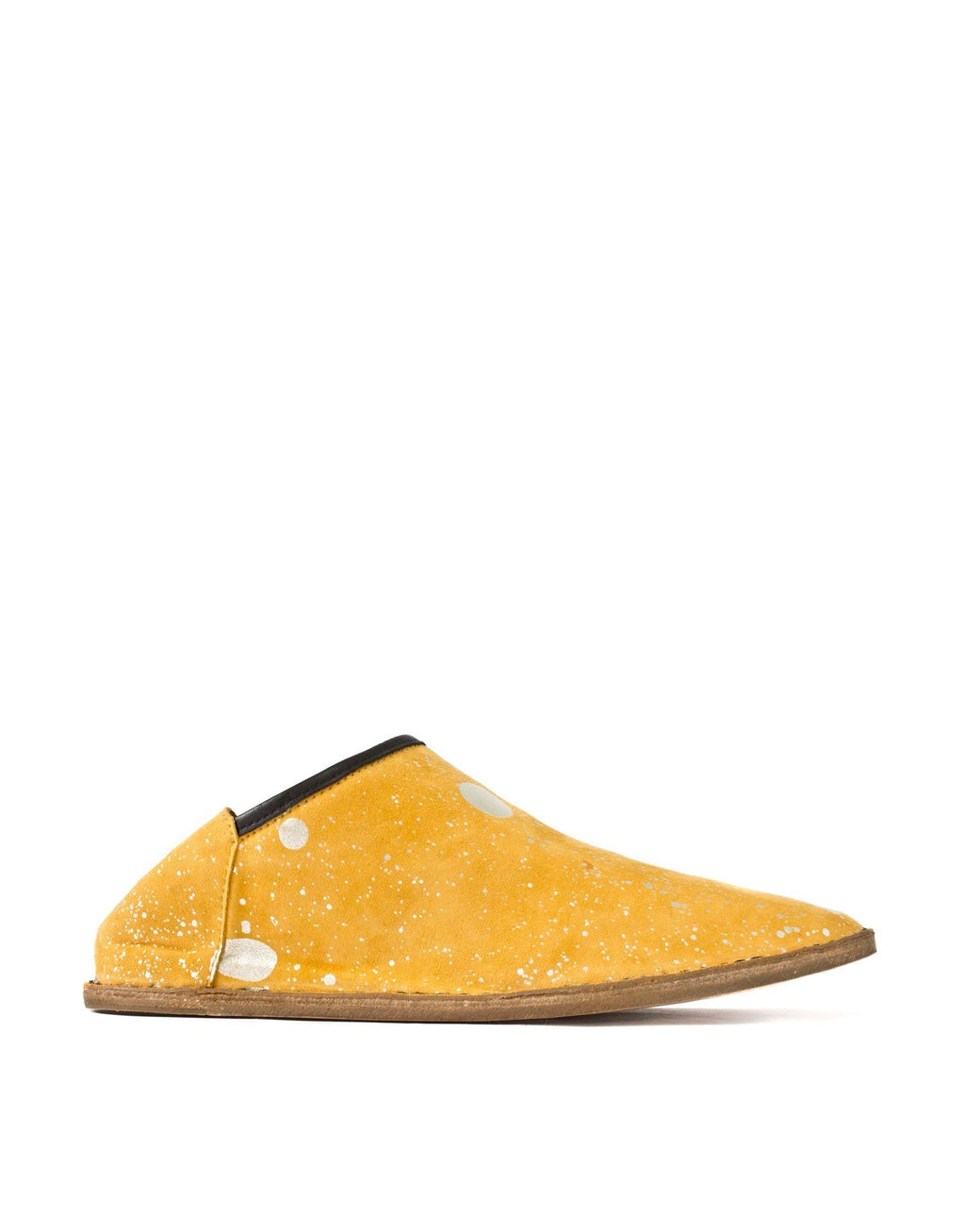 Yellow suede slip on slipper by designer Georgina Goodman. These outdoor shoes with an indoor attitude have a hidden wedge and padded insole for all day comfort in style.