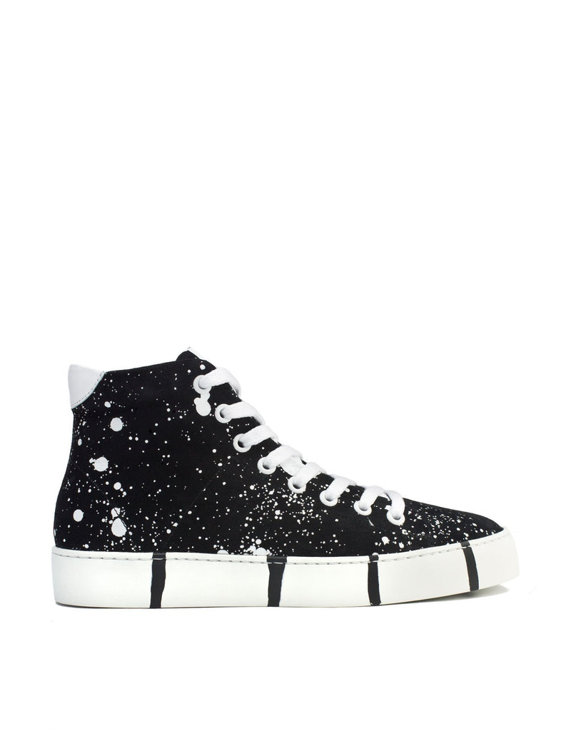 Classic sneaker with a twist art to wear black suede with white splashes by Georgina Goodman