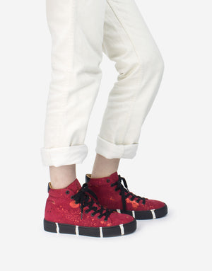 Red high top designer sneaker with recycled sole by designer Georgina Goodman art to wear