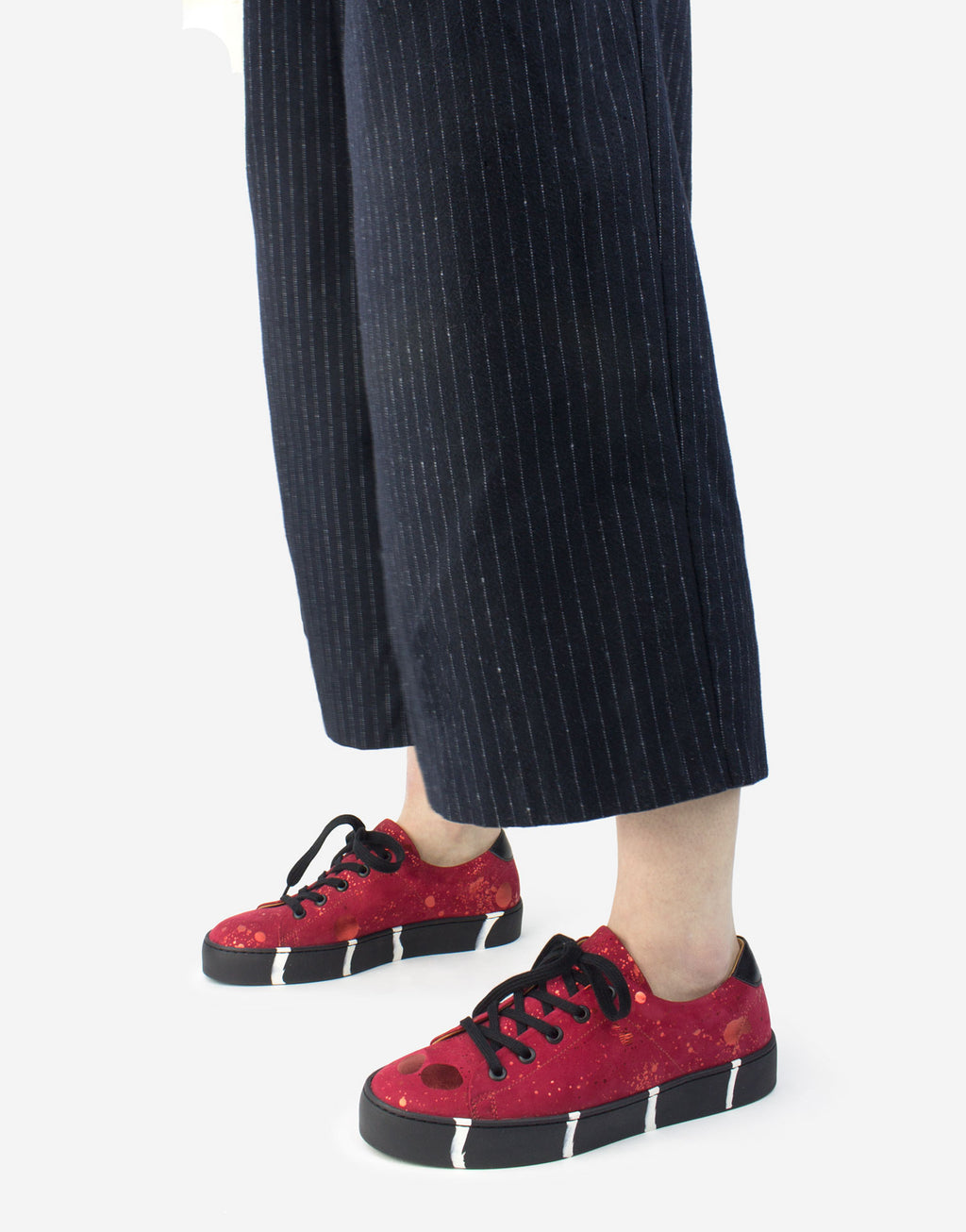 Red sneaker with striped sole by Georgina Goodman made in Portugal