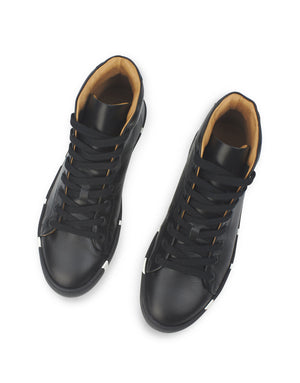 Wardrobe essential black leather high top classic with a twist by designer Georgina Goodman