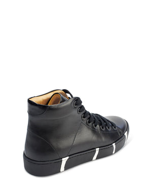 Unique black leather high top with recycled sole featuring signature stripes by Georgina Goodman