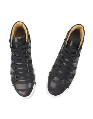 Black and black stripe high top sneaker by Georgina Goodman with signature striped soles