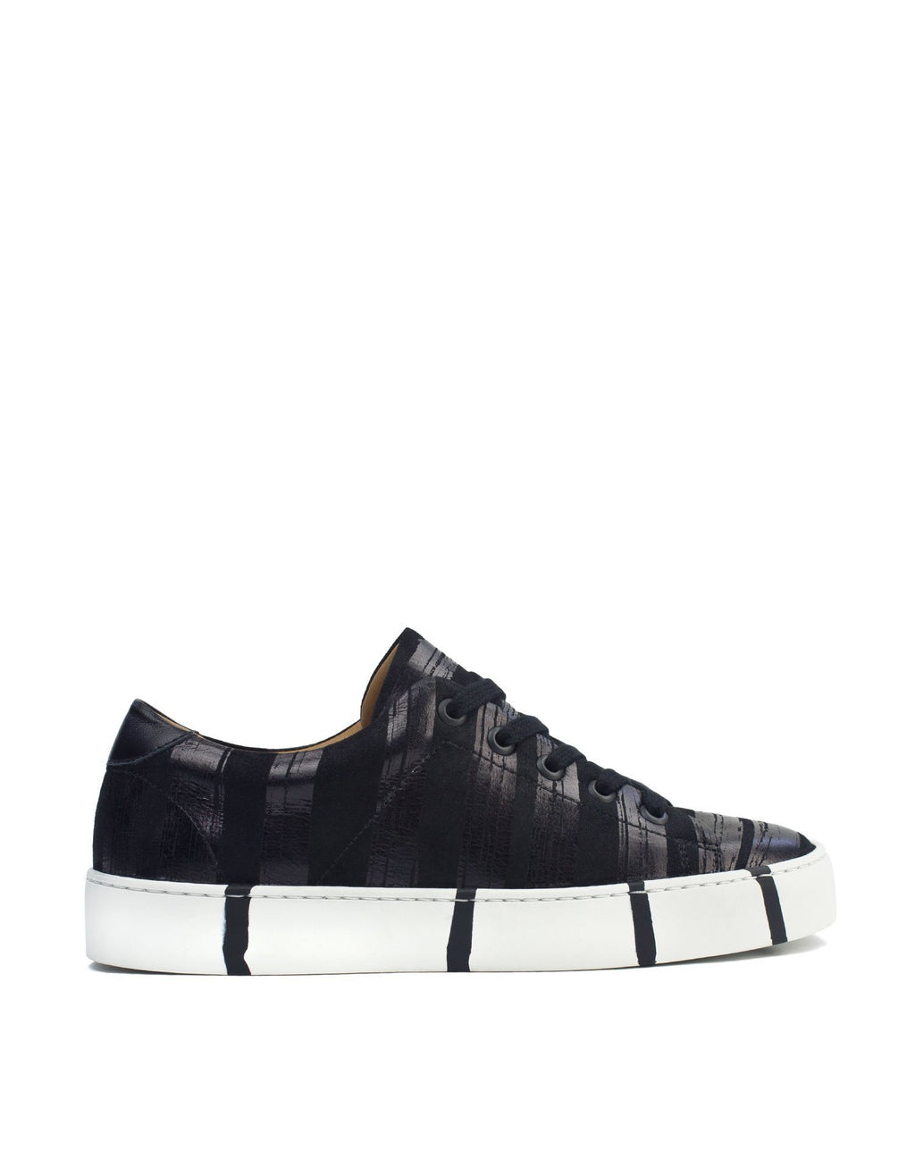 Black and black stripe low top sneaker by Georgina Goodman with signature striped soles