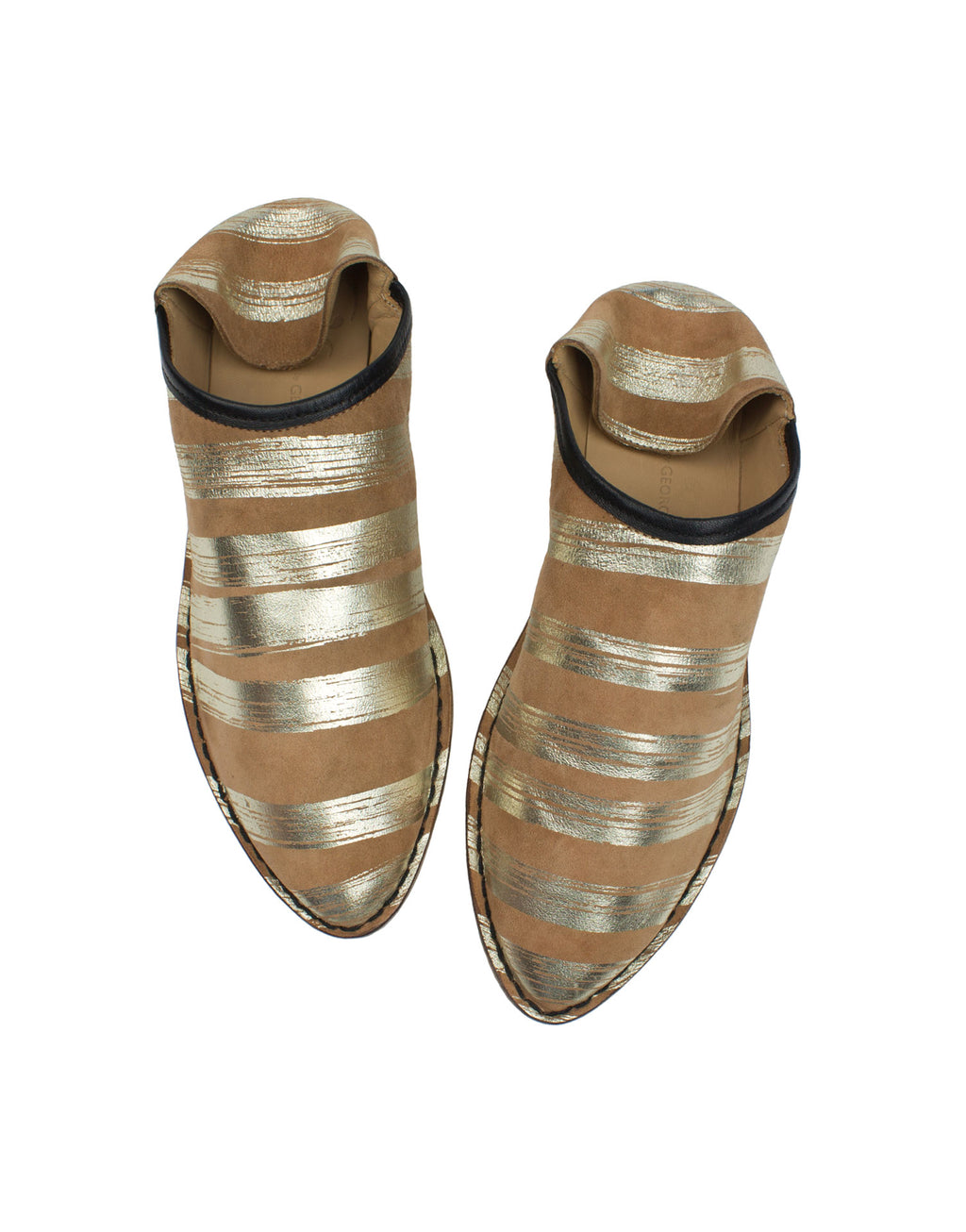 Designer leather slipper by Georgina Goodman in a camel suede with soft platino stripes. This uber comfortable slipper is an outdoor shoe with an indoor attitude.