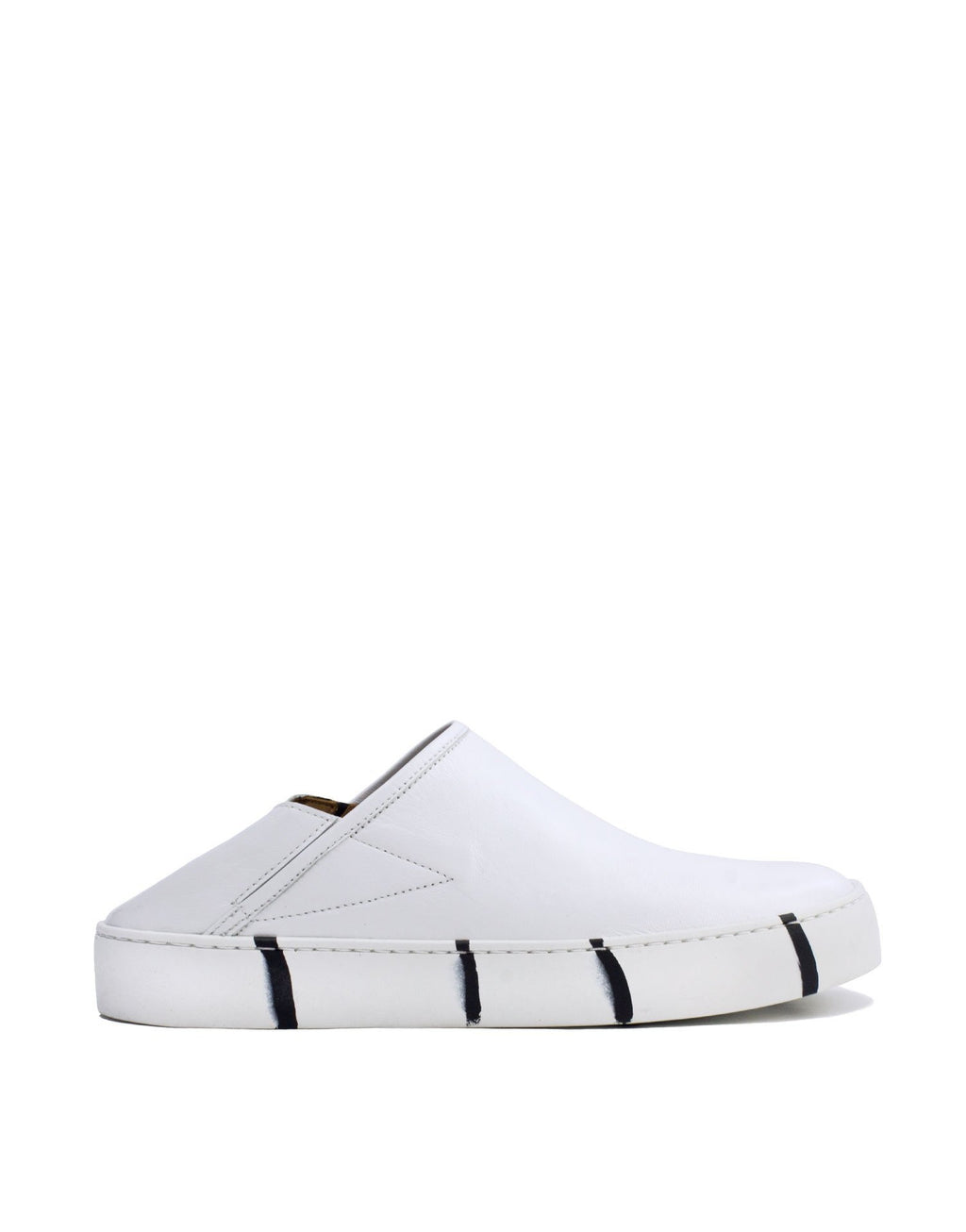 Minimal white leather slip on sneaker by Georgina Goodman With signature black striped sole
