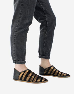 Black and bronze stripe slip on shoe by designer Georgina Goodman, wear with the back up or down.