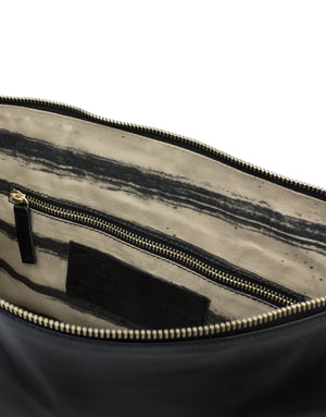 Internal pockets keep smaller items safe in this oversized leather clutch by designer Georgina Goodman. Hand Painted leather pouches available soon.