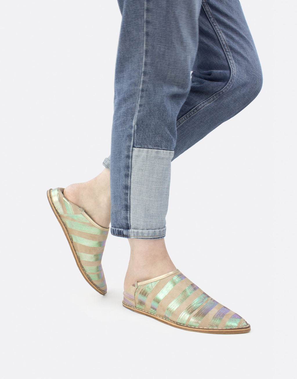 Neutral suede slip on slipper shoe with iridescent pink green metallic brushstroke stripes by designer Georgina Goodman