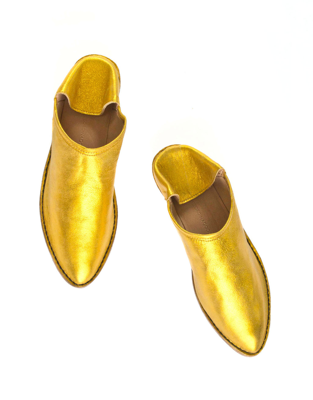 Slip on slipper shoe by designer Georgina Goodman in a vibrant metallic yellow suede, this is an unworn selling sample sold at a discounted price, effortless style for any age