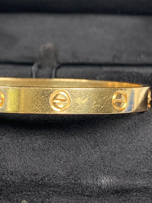 CARTIER - LOVE BRACELET IN 18K YELLOW GOLD - SZ 17