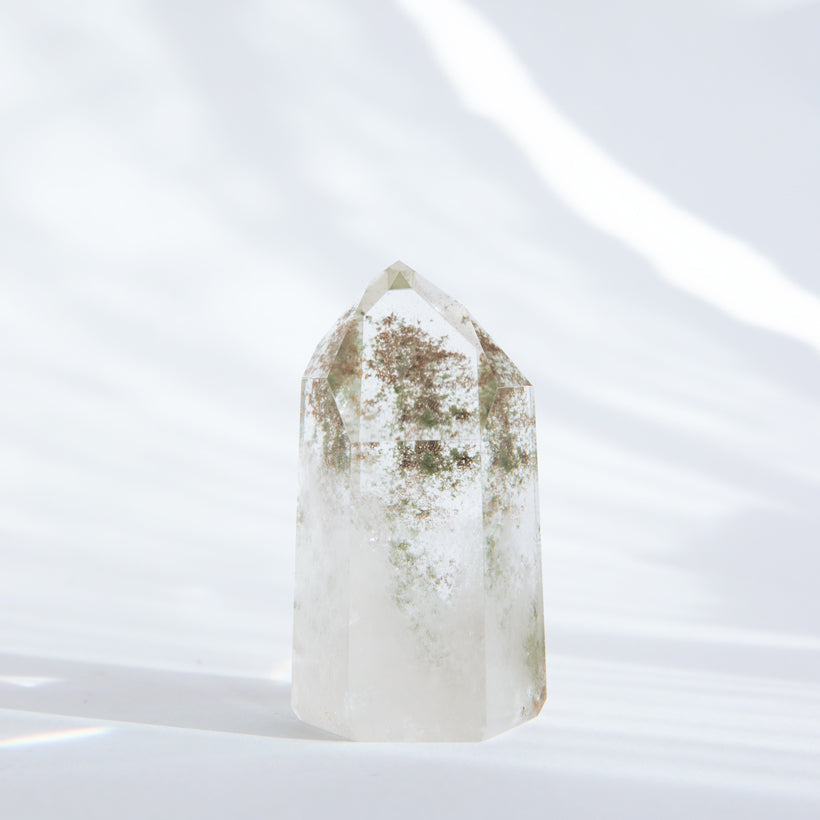 large clear quartz point with chlorite inclusions