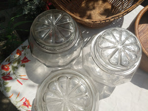 Three Clear Glass Square Storage Canisters with tight seal starburst design lids