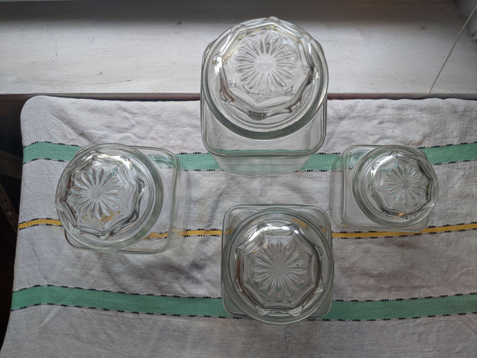 Set of Four clear Anchor Hocking Glass Square Storage Canisters rounded corners with octagon starburst design lid