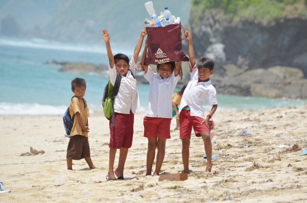 Indonesian Kids Collecting Plastic Rubbish