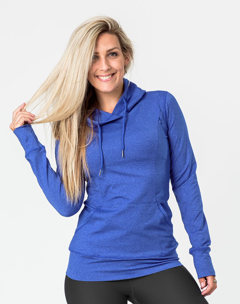 active mother wearing a blue breastfeeding hoodie and leggings