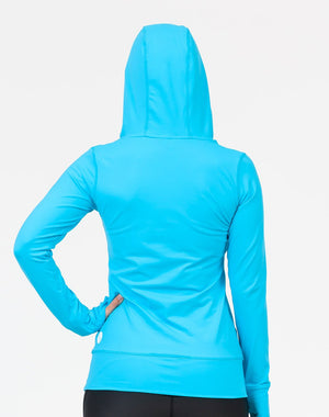 back view of a mom wearing a sky blue activewear breastfeeding hoodie with the hood up