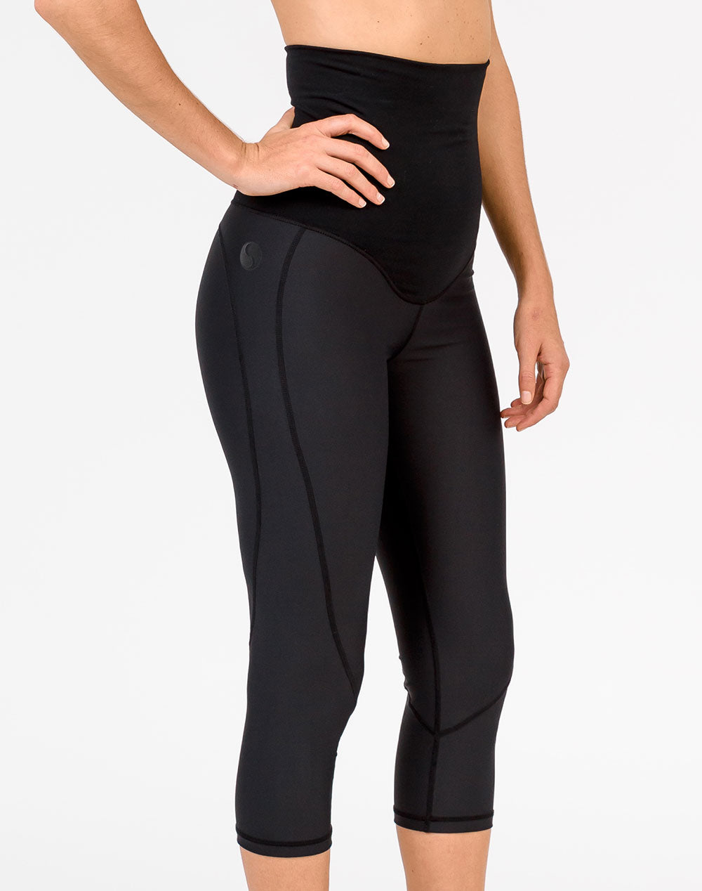 front view active mom wearing black 3/4 maternity leggings