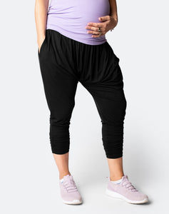 front view of a mom wearing black maternity harem pants