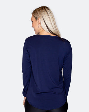 back view of a mom wearing a blue top with a scooped hem