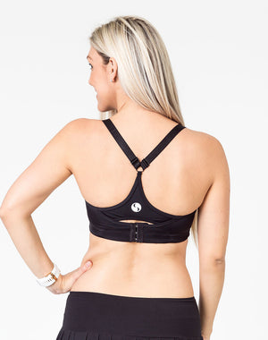 back view of a mom wearing a black maternity activewear bra with a racerback