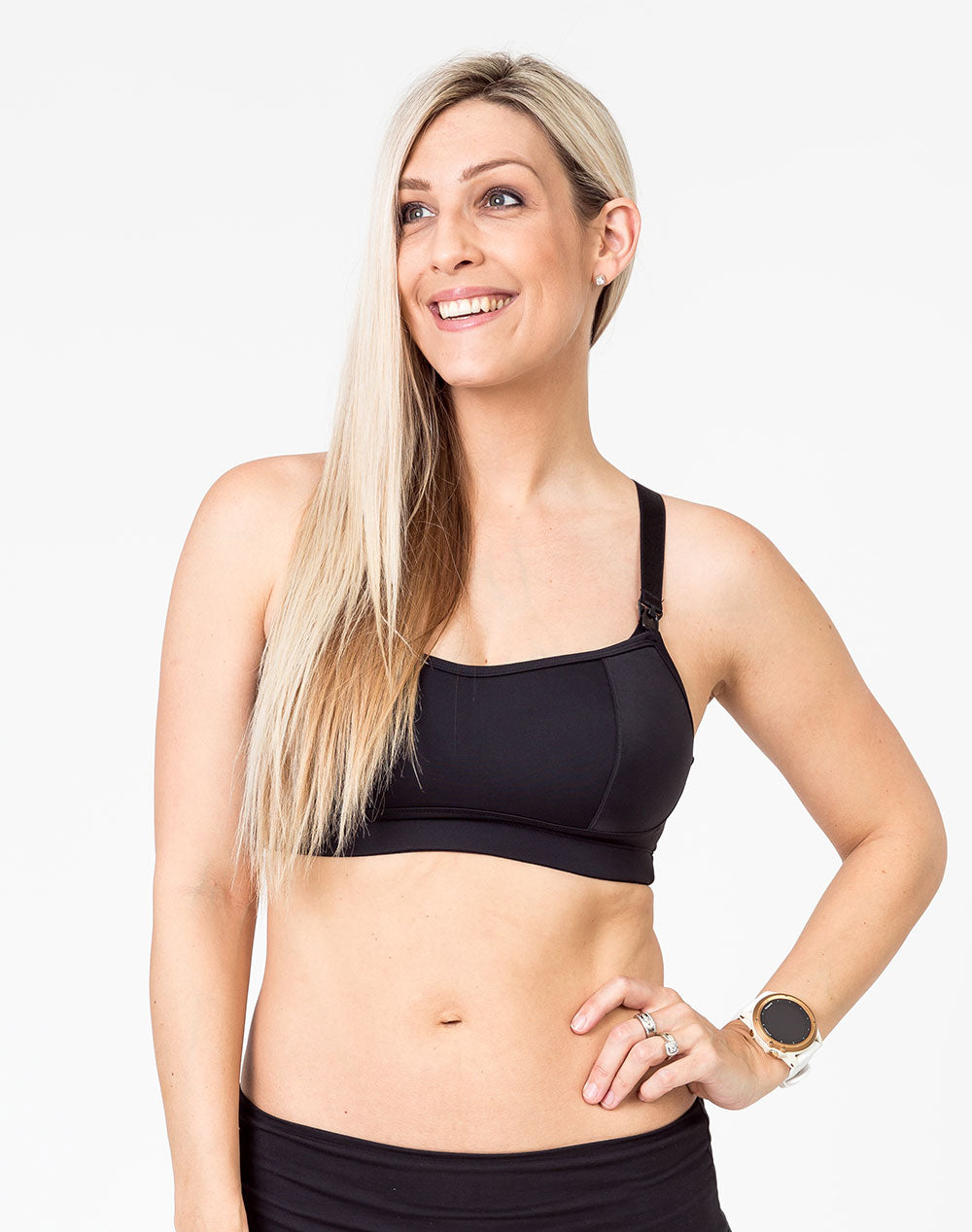 front view of a mom wearing a black maternity activewear bra
