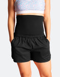 front view of woman wearing black high waisted running shorts