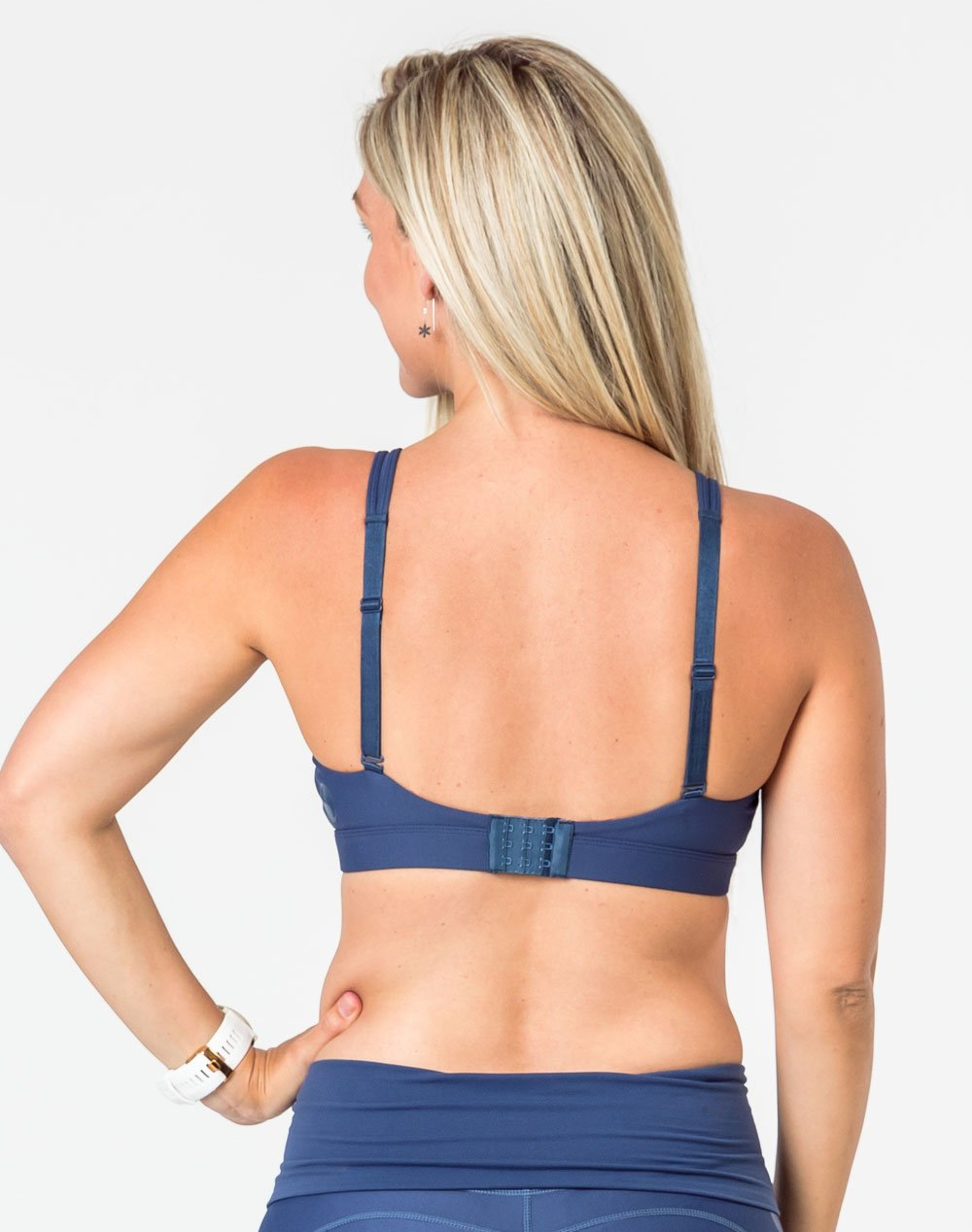 back view of a pregnant lady wearing a matching blue breastfeeding bra and leggings set