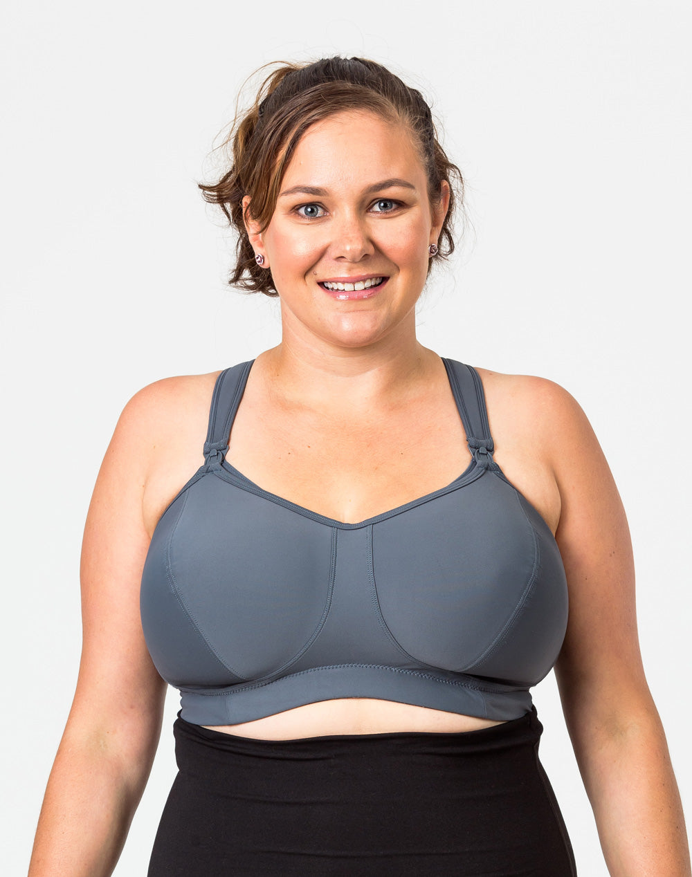 front view of a mom-to-be wearing a plus size nursing bra with drop down cups for easy breastfeeding