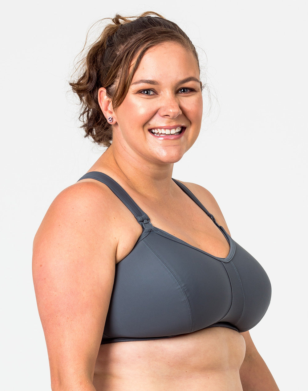 side view of an active mom wearing a supportive plus size nursing bra in a charcoal color