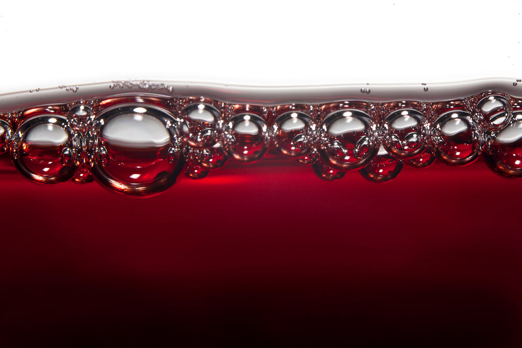 aerated red wine with bubbles