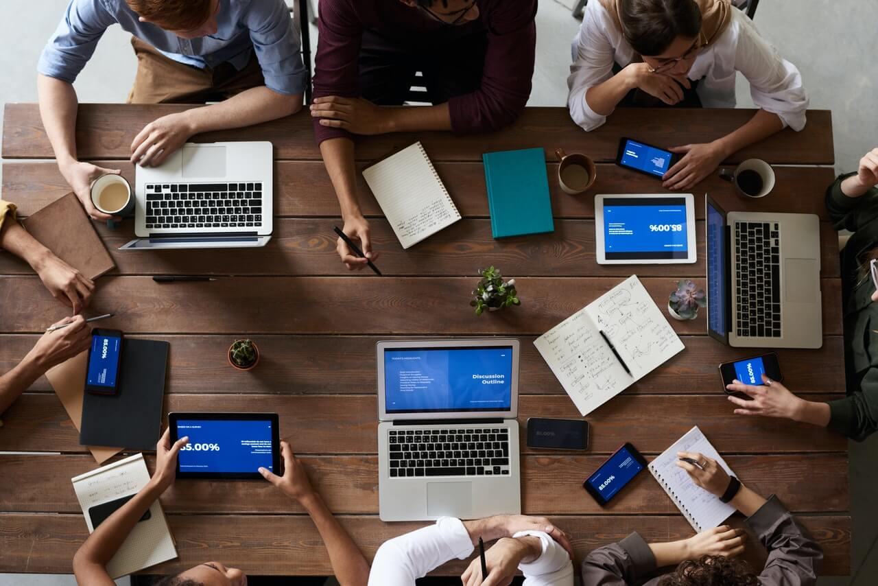 Group of marketing professionals working at a wooden table