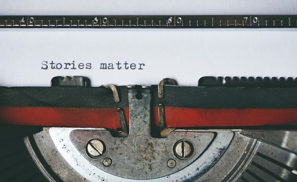 old-fashioned typewriter with a paper that has the words 'stories matter'