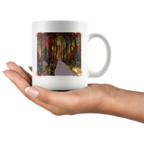 Mug with a painting of an elegantly classic house in the evening, surrounded by fall leaves