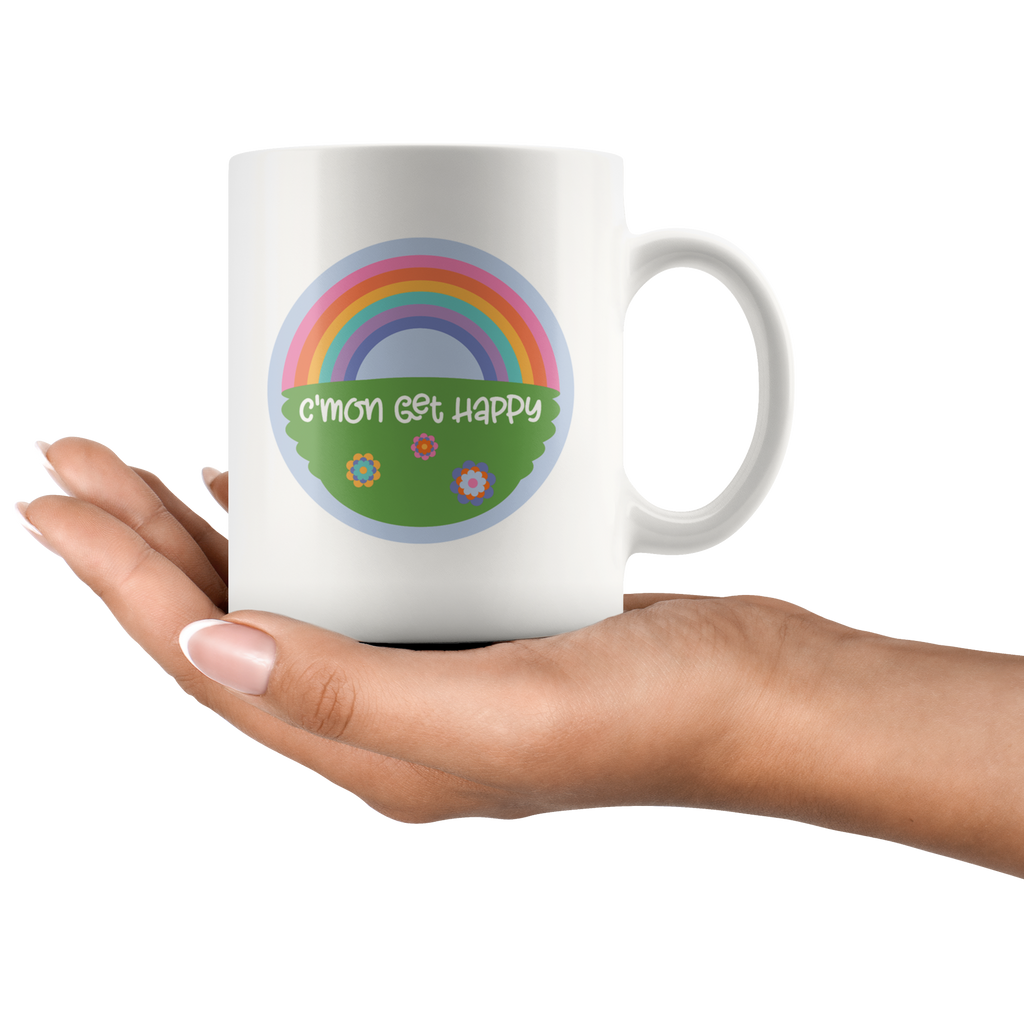 C'mon get happy mugs - rainbow over a grassy field