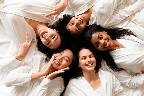 A happy and diverse group of women after a good skincare day.
