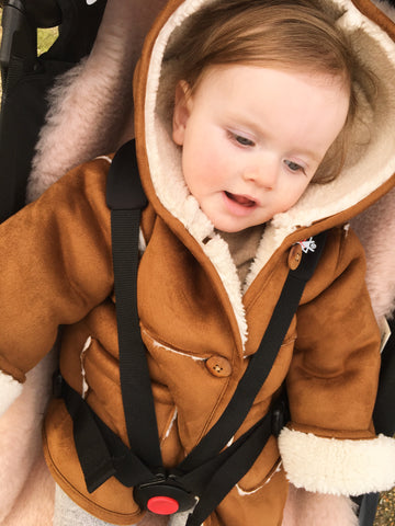 baby sat on binibamba sheepskin pram liner in her baby zen buggy