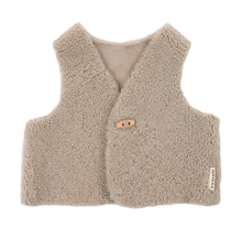 Load image into Gallery viewer, Binibamba toast sheepskin gilet for babies in curly merino sheepskin with wooden toggle