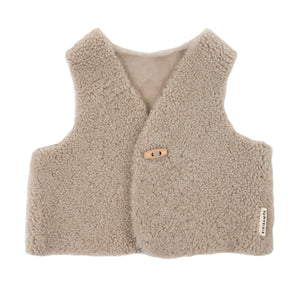 Binibamba toast sheepskin gilet for babies in curly merino sheepskin with wooden toggle