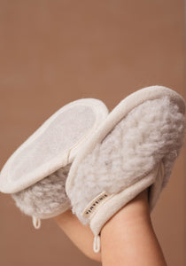 Sheepskin baby slippers made from merino wool with leather soles and suitable for babies from newborn