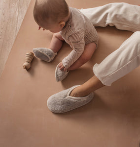 merino sheepskin baby booties in cloud grey with leather soles and available from newborn to two years
