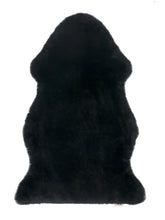 Load image into Gallery viewer, Binibamba black sheepskin wriggle mat rug for babies to use as a natural playmat