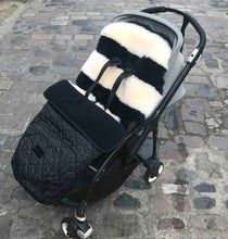 Load image into Gallery viewer, monochrome sheepskin stripe buggy liner shown in pushchair with footmuff