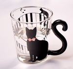Black Cat Fans can't resist mugs with Black Cats! Our Black Kitty Glass Mugs have tails for handles and are perfect for any hot or cold beverage. Black Cat with Music Notes and Keyboard Motif and Cat Tail Handle