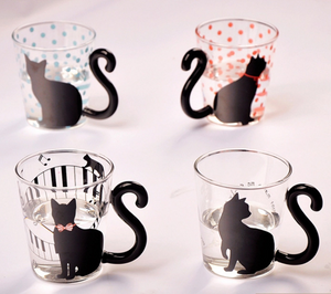 Black Cat Fans can't resist mugs with Black Cats! Our Black Kitty Glass Mugs have tails for handles and are perfect for any hot or cold beverage. Buy one or a whole set of 4!