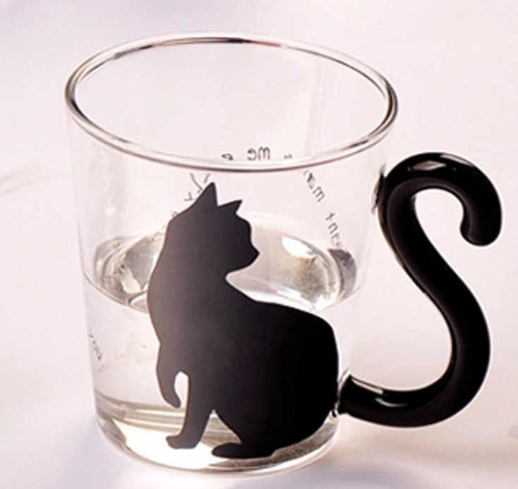Black Cat Fans can't resist mugs with Black Cats! Our Black Kitty Glass Mugs have tails for handles and are perfect for any hot or cold beverage. Black Cat with Cat Tail Handle