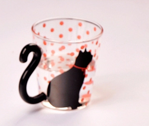 Black Cat Fans can't resist mugs with Black Cats! Our Black Kitty Glass Mugs have tails for handles and are perfect for any hot or cold beverage. Black Cat with Orange Bowtie and Dots and Cat Tail Handle